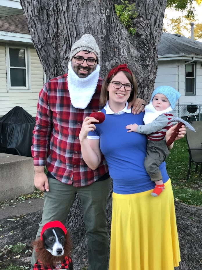 photo (from left to right): Dog in lumberjack costume, Kamran in dwarf costume, Cassie in Snow White costume, and baby Rami in dwarf costume